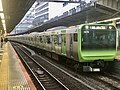 Series E235 Tou 15 Final Gear wrapping in Shinjuku Station.jpg