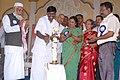 Shri P. Viswanathan, MP, lighting the lamp to inaugurate the Bharat Nirman Public Information Campaign at Maduranthakam, Kancipuram district in Tamil Nadu. The Chairperson Maduranthakam Municipality, Smt. Malarvizhi Kumar.jpg