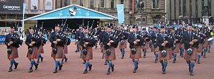 Pipe band - Canada's Simon Fraser University Pipe Band, winner of six World Pipe Band Championships, performing in George Square, Glasgow