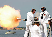 A saluting cannon fired on the arrival of a dignitary.
