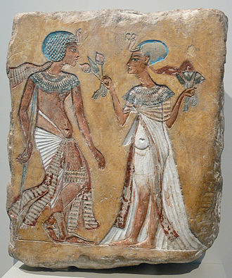 Amarna Period - A relief of a royal couple in the Amarna-period style; figures may be Akhenaten and Nefertiti, Smenkhkare and Meritaten, or Tutankhamen and Ankhesenamun; Egyptian Museum of Berlin.
