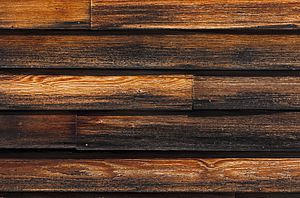 Clapboard (architecture) - Clapboard siding stained dark brown