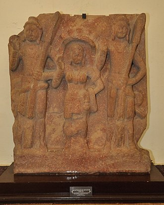 Shashthi - Kushan-era image of Shashthi between Skanda and Vishakha, c. 2nd century CE, Mathura Museum.