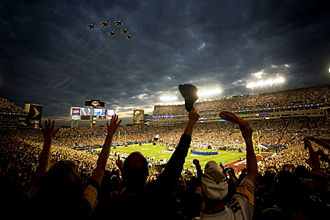 Super Bowl XLIII - Fans wave as the United States Air Force Thunderbirds fly over the stadium during the pregame ceremony.