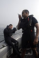 Surface search and rescue (SAR) swimmers Lt. Patrick Panjeti, right, and Seaman David Swan, conduct SAR training alongside the Nimitz-class aircraft carrier USS John C. Stennis (CVN 74) 080517-N-6736S-136.jpg