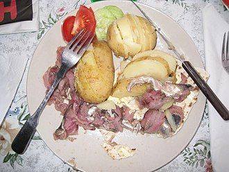 Surströmming - Surströmming served on flatbread with boiled potatoes and salad.