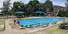 Trained Instructors teach children how to swim in Swifts Creek, Victoria, Australia