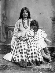 Ta-ayz-slath, wife of Geronimo, and one child