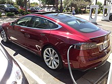 Tesla Model S with charging cable connnected