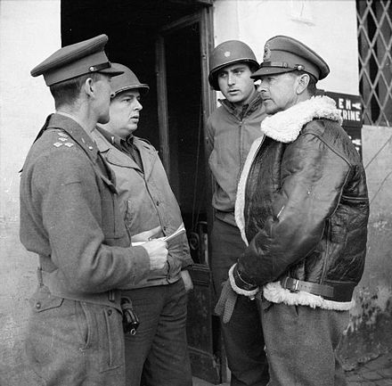 General Sir Harold Alexander, (right, wearing Irvin jacket) commanding 15th Army Group, talks to American and British officers in Anzio, 14 February 1944. The British Army in Italy 1944 NA11881.jpg