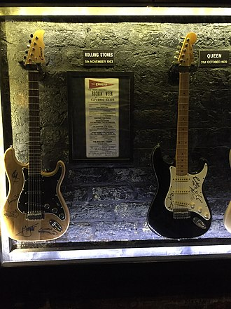 Queen (band) - Queen guitar (right, next to a Rolling Stones guitar) at the Cavern Club in Liverpool, marking a 31 October 1970 Queen concert at the venue