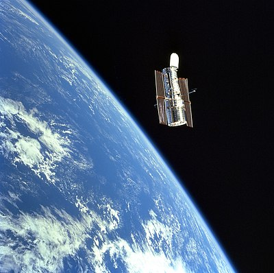 The Hubble Space Telescope (HST) floats gracefully above the blue Earth after release from Discovery's robot arm after a successful servicing mission.jpg