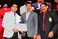 The Minister of State for Youth Affairs and Sports (IC) and Information & Broadcasting, Col. Rajyavardhan Singh Rathore presenting the awards, at the Closing Ceremony of the 22nd National Youth Festival (1).jpg