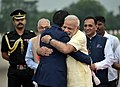 The Prime Minister of Japan, Mr. Shinzo Abe being welcomed by the Prime Minister, Shri Narendra Modi, at Ahmedabad airport, Gujarat.jpg
