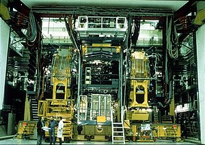UA2 experiment - Detector for the UA2 experiment. The picture shows the detector after the 1985-1987 upgrade, when new end-cap calorimeters were added to improve the search for the top quark and new physics.