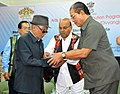 The Union Minister for Social Justice and Empowerment, Shri Thaawar Chand Gehlot distributing the Aids & Appliances to the Person with Disabilities (Divyangjan), in Aizawl.jpg