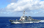 The guided missile destroyer USS Curtis Wilbur (DDG 54) steams through the Philippine Sea Aug. 19, 2013 130819-N-GC965-088.jpg