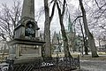 Thomas Angell (1692–1767) minnesmerke obelisk 1895 bust monument architect Karl Norum sculptor Carl Ludvig Jacobsen (orginal Hans Michelsen) Nidaros Cathedral Bispegata Trondheim Norway 2019-03-20 bare trees wet rainy grey etc 09682.jpg