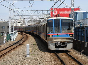 Toei Mita Line - A Toei 6300 series EMU arriving at Hasune Station