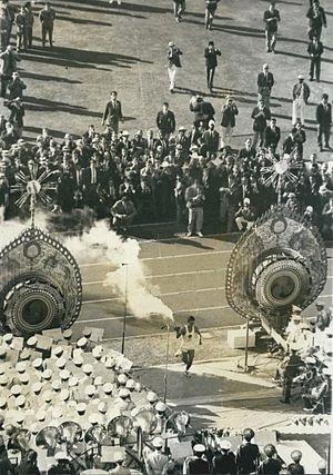 1964 Summer Olympics - Yoshinori Sakai running to the Olympic cauldron.