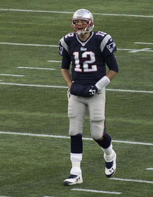 Brady with his hands in a warmer