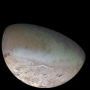 Solid nitrogen - Much of the surface of Triton is covered in the hexagonal form of solid nitrogen (the β crystal phase), which can be seen as a bluish green band around the equator in this synthetic color photomosaic.