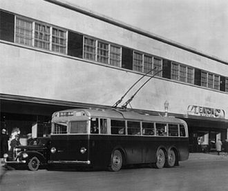 Trolley buses in Edmonton - Leyland trolley bus in front of Eaton's department store, ca 1940.