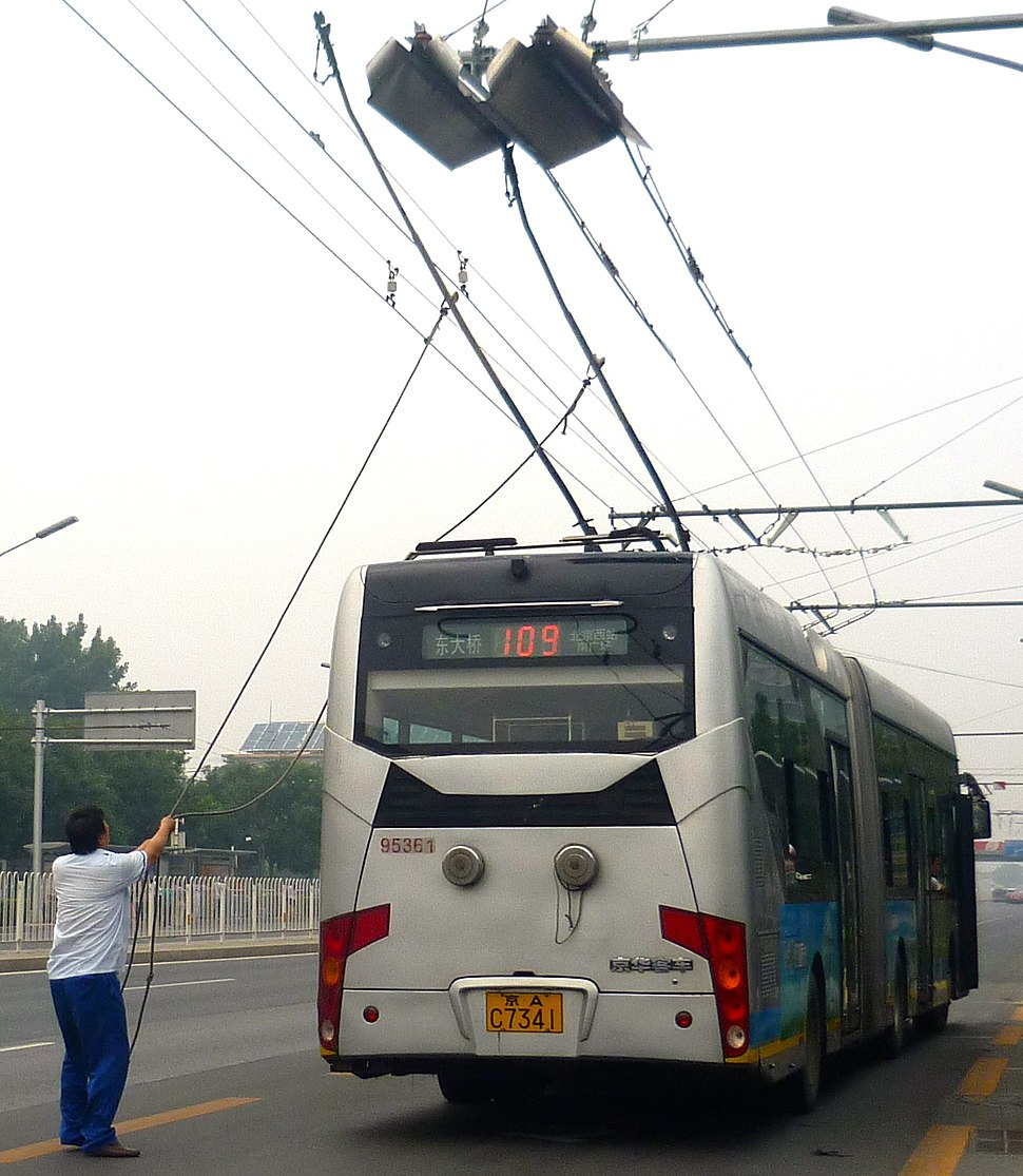 Trolleybus Driver Adjusting Trolley Pole (cropped)