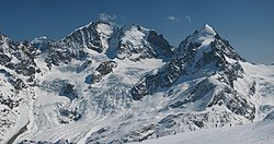 Piz Bernina (centre-left) with the Biancograt to the left, Piz Scerscen (centre-right) and Piz Roseg (right), seen from Piz Corvatsch