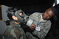 U.S. Air Force Maj. William McGhee, right, a medical logistics officer with the 439th Aeromedical Evacuation Squadron out of McChord Air Force Base, Wash., assists Tunisian army Maj. Sarra Bouhafa, a forensic 081113-F-ML440-015.jpg