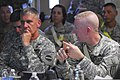U.S. Army Gen. David M. Rodriguez, left, the commander of Army Forces Command, listens to Col. Bret Van Camp, the commander of the 1st Maneuver Enhancement Brigade, during a briefing for exercise Vibrant 120731-A-ZZ999-304.jpg