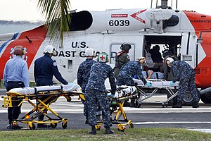Sikorsky MH-60 Jayhawk - Haitian earthquake victims are unloaded from a HH-60J at U.S. Naval Hospital Guantanamo Bay.
