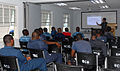 U.S. Navy Engineman 1st Class Kevin Nichols speaks about small boat operations and navigation with members of the Barbados defense forces during a subject matter expert exchange in Bridgetown, Barbados, Aug. 24 100824-N-GH121-010.jpg