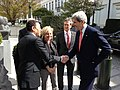 U.S. Secretary of State John Kerry is greeted by U.S. Ambassador to the European Union William E. Kennard as U.S. Ambassador to the Kingdom of Belgium Howard Gutman and his wife look on in Brussels.jpg