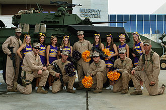 East Carolina University - East Carolina Cheerleading squad with members of the II Marine Expeditionary Force.
