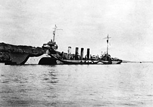 USS Beale (DD-40) moored to a buoy at Queenstown, Ireland, in 1918. She is painted in pattern camouflage.