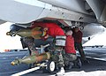 US Navy 030305-N-4655M-004 Aviation Ordnancemen install a GBU-31 Joint Direct Attack Munitions.jpg