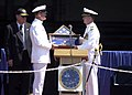 US Navy 030807-N-1397H-004 USS Constellation (CV 64) Commanding Officer, Captain John W. Miller, is presented the ships Commissioning Pennant by Command Master Chief Mark D. Hayes during the ships decommissioning ceremony.jpg