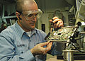 US Navy 040218-N-6278K-001 Aviation Electronics Technician 2nd Class Bill Gardner solders components on a printed circuit board.jpg