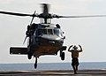 US Navy 040423-N-9742R-004 Aviation Boatswain's Mate 3rd Class Ifoma Givens, of Philadelphia, Pa., directs an MH-60S Knighthawk.jpg
