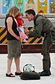 US Navy 040522-N-0435H-002 Lt. Cmdr. John Mann greets his wife and son after his return from a deployment.jpg