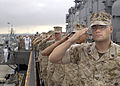US Navy 040527-N-8859S-007 Marines and Sailors salute the Ensign during morning colors as the USS Belleau Wood (LHA 3) prepares to depart for a six-month deployment.jpg