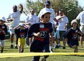 US Navy 040603-N-0780F-035 A student from the Therapeutic and Rehabilitation Center for Children and Youth School in Chania, Crete nears the finish line in a race.jpg