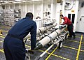 US Navy 040911-N-9228K-023 Aviation Ordnancemen assigned to the Weapons Department aboard the aircraft carrier USS Abraham Lincoln (CVN 72) team up to move a rack of AGM-88 HARM Missiles inside the forward ammo magazine.jpg