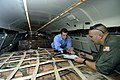 US Navy 050909-N-5328N-368 Aviation Structural Mechanic 2nd Class Bill Hartig, loadmaster onboard a U.S. Navy C-9 Skytrain cargo plane assigned to VR-52 explains to Andrew McIntosh, a reporter from Pensacola, Fla.-based WEAR-TV.jpg