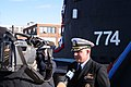 US Navy 051123-N-0653J-003 Commanding Officer, USS Virginia (SSN 774), Cmdr. Todd Cramer, answers questions from local media about his submarine.jpg