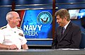 US Navy 070120-N-0318S-001 Deputy Vice Cmdr., Naval Air Systems Command, Rear Adm. Richard J. Wallace, talks with Mr. Bill Murphy, host for Fox News 13 Good Day Tampa Bay morning show about Tampa Navy Week.jpg
