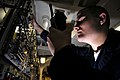 US Navy 070305-N-2659P-061 Electronics Technician Seaman Cliff Bunnowsky checks power inputs for Ultra High Frequency (UHF) radios used for ship-to-ship and shore communications in the Ultra High Frequency radio room.jpg
