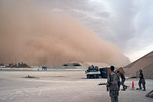 US Navy 070521-N-0000X-021 Sailors prepare to take cover as a sandstorm engulfs the Hardened Aircraft Shelter at Al Asad Air Base, Iraq.jpg