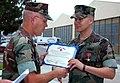 US Navy 070806-N-0640K-012 Utilitiesman 1st Class Josh Hullsiek receives the Bronze Star Medal from Capt. Steve Wirsching, commanding officer of Naval Facilities Engineering Command (NAVFAC) Southwest.jpg